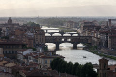 View of Florence in the evening light with the Ponte Vecchio bridge. Italy Royalty Free Stock Images