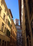 View of Florence. Picturesque street in Florence with view of Giotto's bell tower, Italy Stock Photo
