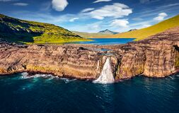 View from flying drone. Spectacular afternoon view of Bosdalafossur waterfall. Dramatic summer scene of Sorvagsvatn lake, Vagar, F