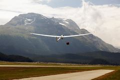 A view of a flying glider in the airport of St Moritz in the alps switzerland.  Stock Photo