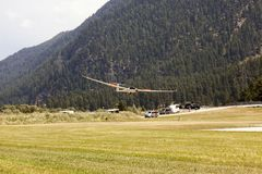 A view of a flying glider in the airport of St Moritz in the alps switzerland.  Royalty Free Stock Image