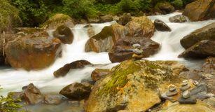 View of flying water in the mountain river stock images