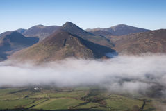 View of Fog Clearing over Newlands Valley, Cumbria. Morning fog clearing over Newlands Valley, Cumbria, UK Stock Images