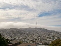 View of fog overtaking Sutro Tower and Twin Peaks in San Francis Royalty Free Stock Photo