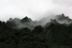 View of foggy mountains, at Fox Glacier, New Zealand. View of foggy, jagged mountains fro on the glacier stock image