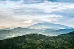 View on foggy peaks of mountains stock photos