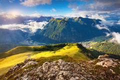 View of the foggy Val di Fassa valley with passo Sella. National Stock Photo