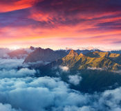 View of the foggy Val di Fassa valley with passo Sella. National Royalty Free Stock Image