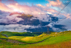 View of the foggy Val di Fassa valley with passo Sella Royalty Free Stock Photo