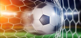 Football ball in the net of a goal - 3d rendering Royalty Free Stock Photo