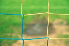 View from football gate to water and mude in poor soccer field. Damaged lawn in outdoor football stadium Royalty Free Stock Photos