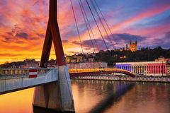 View of footbridge on Saone river at sunset Royalty Free Stock Images