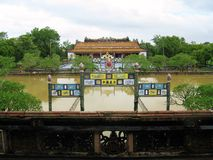 View on the forbidden city. A view of Hue's citadel from the entrance gate. Behind the door and the square (covered in water due to that days flooding) it can be Stock Photography