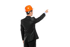 A view of a foreman in a suit pointing. Isolated against white background Stock Photography