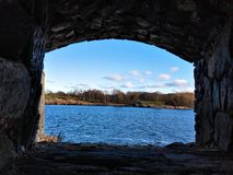 View on forest from loophole on the island of Suomenlinna. Finland stock image