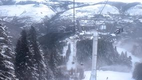 View of the valley from a height from the window of the moving cabin of the lift of the ski station. stock video footage