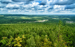View of forest, mountains, fields, cottages from Lipovaya Mount Stock Image