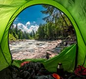 View form tent to cold river in Tatras in summer stock image