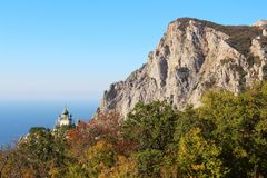 View of Foros Church and Foros Mountain in the autumn. View of Foros Church, also known as The Church of Christ`s Resurrection, and Foros Mount from road through royalty free stock images