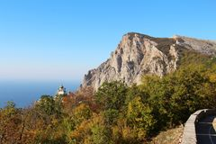 View of Foros Church and Foros Mountain in the autumn. View of Foros Church, also known as The Church of Christ`s Resurrection, and Foros Mount from road through royalty free stock photos