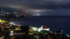 The view from foros in the Eastern part of the coastline in the night lights. The view from foros in the Eastern part of the coastline stock image