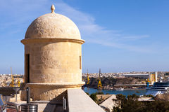 View from Fort Lascaris, Valletta, Malta. View across the Grand Harbour from Fort Lascaris with the shipyards and a docked cruise ship Royalty Free Stock Photo