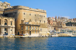 The view of Fort Lascaris from the water of Grand Harbour. Malta. The view of Valletta fortifications with Fort Lascaris and Upper and Lower Barrakka Gardens Royalty Free Stock Image