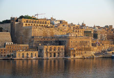 The view of Fort Lascaris from the water of Grand Harbour. Malta. The view of Valletta fortifications with Fort Lascaris and Upper and Lower Barrakka Gardens Royalty Free Stock Photo