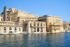 The view of Fort Lascaris from the water of Grand Harbour. Malta. VALLETTA, MALTA - JULY 23, 2015: The view of Valletta fortifications with Fort Lascaris and Stock Images