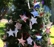 Patriotic christmas tree in fort Myers, Florida, usa. A view in FORT MYERS, UNITED STATES, NOVEMBER 25, 2017 : patriotic decorated christmas tree , november 25 stock photos