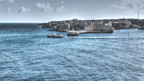 View of Fort Ricasoli, sailing boat, lighthouse Royalty Free Stock Image