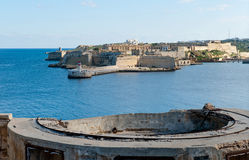 View from Fort St Elmo on to the Ricasoli Grand Harbour East Breakwater and red lighthouse stock photos