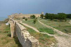 View of fortified wall and watchtower of middle stronghold in ol Royalty Free Stock Image