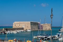 View of the fortress Castello a Mare Koules in Herakleio of Crete in Greece. The Castello a Mare Koules is a fortress located at the entrance of the old port of Royalty Free Stock Photos