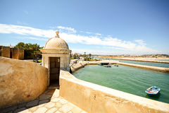 View from fortress Forte da Ponta da Bandeira in Lagos to waterfront with marina and old town, Algarve stock photography