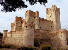 The Castle of the La Mota or Castillo de La Mota. View of the Fortress La Mota Castle. Built from bricks and stone at 14th century-15th century.one of the Stock Photos