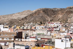 View from the fortress of Moorish houses and buildings along the. Port of Almeria, Andalusia, Spain Stock Photos