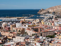 View from the fortress of Moorish houses and buildings along the port of Almeria, Spain Stock Photo