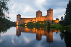 View of the fortress Olafsborg in the twilight. Savonlinna, Finland Stock Photos