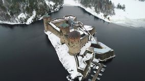 View of the fortress Olavinlinna, March day aerial video. Savonlinna, Finland stock footage