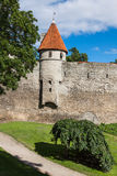 View of fortress towers and church on sky background. Tallinn. E Stock Photos
