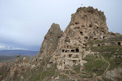 View of the fortress of Uchisar and the cave city. Cappadocia, Turkey Royalty Free Stock Image
