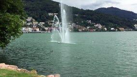 View of fountain on Lake Lugano - Ceresio in Lavena Ponte Tresa, Italy stock video