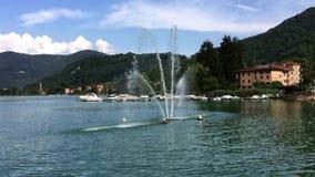View of fountain on Lake Lugano - Ceresio in Lavena Ponte Tresa, Italy stock footage