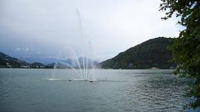 View of fountain on Lake Lugano - Ceresio in Lavena Ponte Tresa, Italy stock video footage