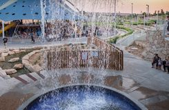 View through fountain on new child amusement park at Beer-Sheva city. South Israel. BEER-SHEVA, ISRAEL - JULY 22, 2017: View through fountain on new child stock photo