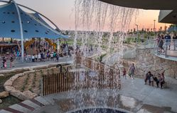 View through fountain on new child amusement park at Beer-Sheva city. South Israel. BEER-SHEVA, ISRAEL - JULY 22, 2017: View through fountain on new child stock photography