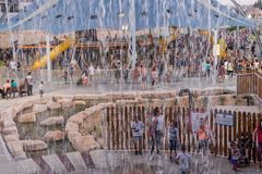 View through fountain on new child amusement park at Beer-Sheva city. South Israel. BEER-SHEVA, ISRAEL - JULY 22, 2017: View through fountain on new child royalty free stock photo