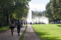 View of a fountain with peoples walking at the north park in Milan stock photos