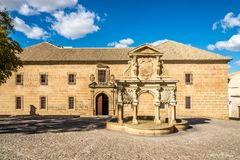 View at the fountain of Santa Maria with st.Philip seminary building in Baeza, Spain. View at the fountain of Santa Maria with st.Philip seminary building in Stock Photos